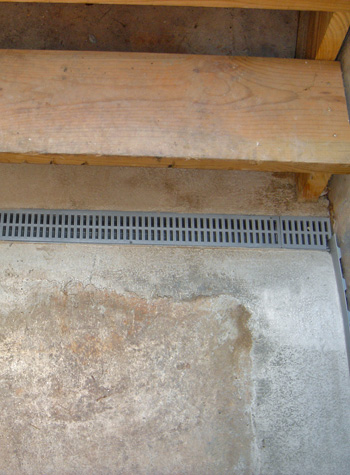 grated French drain system for staircase drainage in Charlottetown, PE